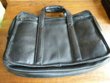 A black leather laptop/brief case in excellent expensive leather