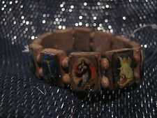 Wonderful wooden elasticated bracelet Claire's with religious images