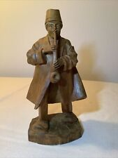 wood hand carved man in fez hat