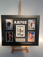 PROFESSIONALLY FRAMED, SIGNED ARNOLD SCHWARZENEGGER PHOTO COLLAGE WITH PLAQUE.