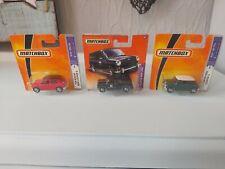 2 Matchbox '64 Austin Mini Cooper S Cars , & Mini Van on card