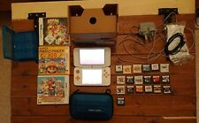 Nintendo 2DS XL White and Orange Console with Games, super Mario bros cover.