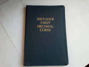 COIN SET BRITAINS FIRST IN A BLUE WALLET UNCICULATED CONDTION