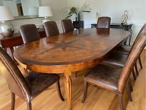Custom Oval Harvest Table Paired With Lillian August Distressed Leather Chairs