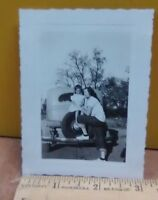 Vintage photo-  Mother, and, daughter on car looks like 1950's era (B-123-1)