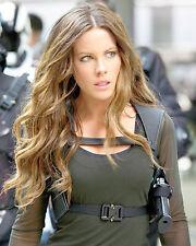 Kate Beckinsale 8x10 sexy action shot with gun holster green dress