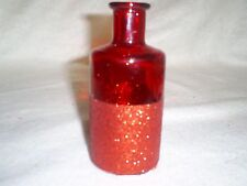 "5.25"" Tall Decorative Round Glass Bottle in Red w/Red Glitter on Bottom Half"