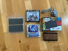 Nintendo 3DS Black Handheld System, With Fire Emblem Warriors And Pokemon Moon.