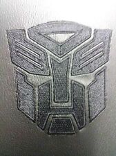 GM 92242459 Transformers Camaro Black Console Lid with Autobot Logo Grey Stitch