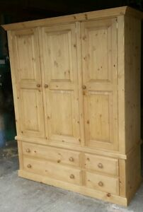 woodstock triple wardrobe four drawer solid pine . Delivery can be  arranged.