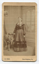 CDV WOMAN STANDING AT ORNATE TABLE HOLDING BOOK. NEW BRIGHTON, PA.