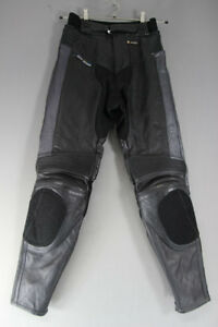 AKITO LEATHER BIKER TROUSERS + CE KNEE ARMOUR: WAIST 28 INCH/INSIDE LEG 31 INCH