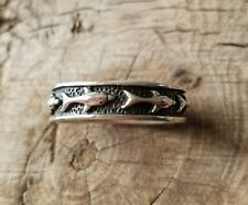 Sterling silver swimming dolphins band ring