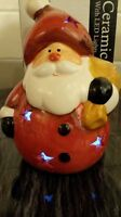 Light Up Christmas santa. Ceramic, Colour changing 14cm high battery operated