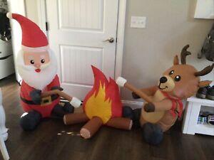 Christmas inflatable Santa and reindeer campfire