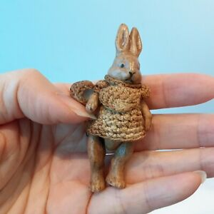 """622 Antique German Hertwig Mama Rabbit in brown outfit w basket & apron, 2 5/8"""""""