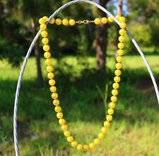 """NECKLACE is a string of 13mm pearl tinted by a bright yellow imitation 32"""" long"""