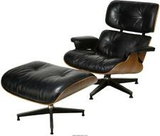 A CHARLES AND RAY EAMES BLACK LEATHER LOUNGE CHAIR AND OTTOMAN FOR ... Lot 65855