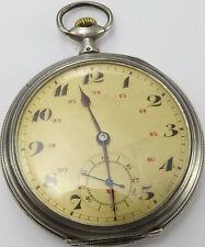 Antique white metal cased slim pocket watch 50mm Diam In good working order.
