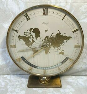 "Kienzle World Time Clock designed by Heinrich Moller, mid 20th C, 10""d, 11-5/8""h"