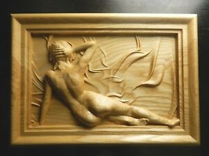 Wood carved picture wall decoration plaque. Nude young woman in frame.
