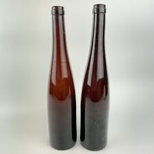 More details for pair of probably antique amber glass narrow glass bottles 35cm high