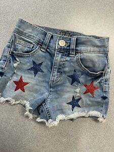 justice shorts size 8 denim jean cut offs with red and blue glitter stars