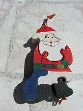 kleiner, niedlicher Holz-Puzzle-Weihnachtsmann