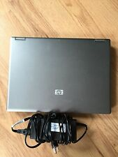 Hp, 12 by 10, grey laptop with charger