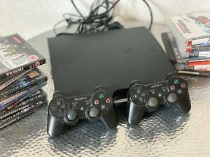 Sony PS3 Slim Console CECH-2503B with 2 controls and 15 games