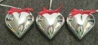 "SET OF 3 SILVER TONE HEART CHRISTMAS TREE ORNAMENTS W/RED RIBBONS 2.25"" TALL"