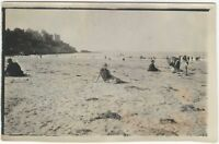 1920s Young Woman in Summer Frock Sits Alone on Busy Beach Snapshot