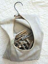 ANTIQUE, VINTAGE LOT OF 50 WOODEN CLOTHES PINS IN ANTIQUE BAG.