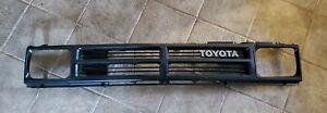 1984 - 1989 Toyota Pickup Truck 4WD Grille & Headlight Bezels OEM Black rare