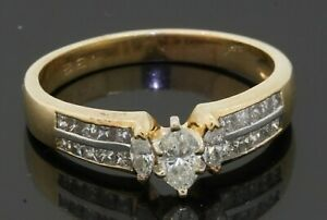 14K gold 1.10CTW diamond wedding/engagement ring w/ .32CT Marquise ctr size 9