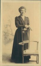 Postcard  Middle Aged Woman Posing Behind Chair studio Shot unposted