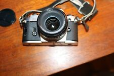 Nikon FG 35mm SLR Film Camera with 50 mm lens beautiful condition. Classic