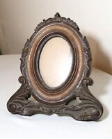 antique ornate hand carved two toned wood oval table picture frame sculpture