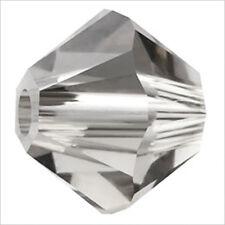 Lot de 40 perles Toupies SWAROVSKI 4mm Crystal Satin