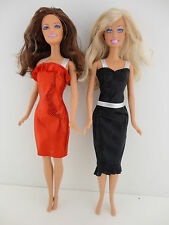 A Set of 2 Metallic Cocktail Dresses in Red and Black Made to Fit the Barbie Dol