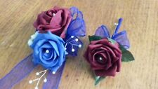 Wrist corsage and buttonhole, royal blue and burgundy.