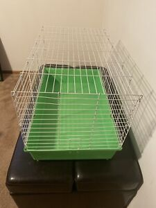 30x18x7 Small Animal Cage with green base  by Kaytee. Used Good condition