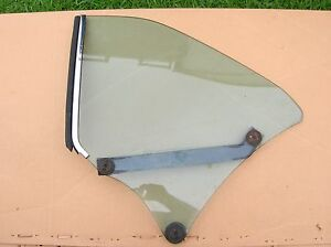 1966-67 Buick Skylark driver side rear 1/4 glass.2-dr hard-top.Factory tinted.