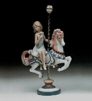 "Llado ""Girl on Carousel Horse"" item #1001469, Retired in 2005, Issued in 1985"