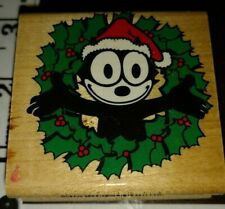 Felix the cat, inside Holly wreath, inkadinkado,501,rubber, wood