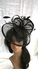 Black Sinamay & feather saucer disc fascinator,.Wedding.races.headband