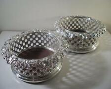 Pair of Ornately Decorated Silver Plated Wine Bottle Coasters: Birmingham c1850