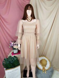 cherrie424: Nude Mesh Midi Dress