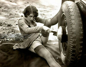 1930s Studio Biederer Photo Woman in Stockings Changing Car Tire - 11x14 Poster