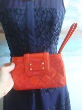 Kate Spade Orange Quilted Mini Wristlet - $129!